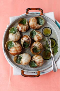 The escargot is a cooked land snail filled with butter, garlic, and parsley. Discover French cuisine at http://www.talkinfrench.com/50-fabulous-french-foods/