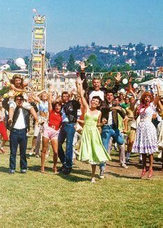 Grease. Love their funfair attire.