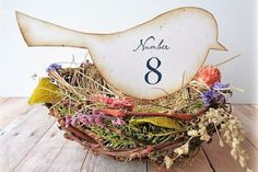 Perch these handmade bird cutouts atop a dried floral nest for a charming rustic look.