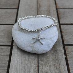 Pulsera estrella de mar y bolas zamak