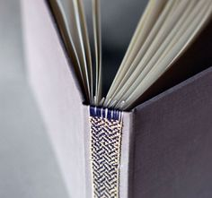 Natalie Stopka.  The spine detail is hand woven in linen and cotton tape