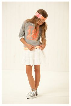 White ruffled skirt, grey and orange peach graphic sweatshirt, and converse. Comfortable and cute outfit for girls and teenages