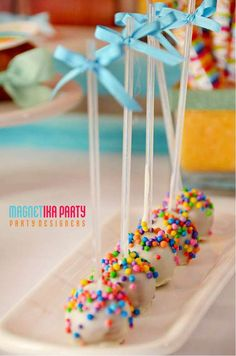 Awesome cake pops at a rainbow birthday party! See more party ideas at CatchMyParty.com!