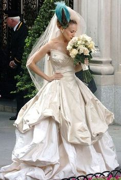 Sarah Jessica Parker in the gorgeous Vivienne Westwood dress. I love the bird hair piece too!