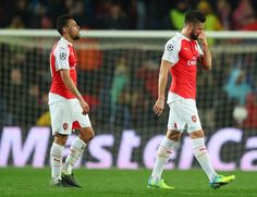 Olivier Giroud (R) and Francis Coquelin (L) of Arsenal leave the pitch after their 1-3 defeat in the UEFA Champions League round of 16, second Leg match between FC Barcelona and Arsenal FC at Camp Nou on March 16, 2016 in Barcelona