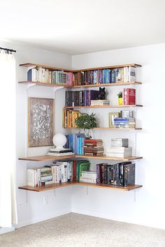 DIY corner shelving system, via decoist. #books #shelves #library