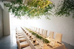 Hanging greenery makes this indoor garden themed wedding reception chic and modern.