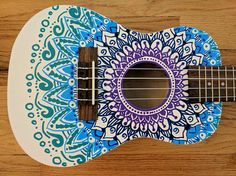 Beautiful hand painted white concert size (23) ukulele with a mandala design. Mandala, a sanskrit word meaning circle, represents balance and harmony. This ukulele is sure to bring harmony to your life when you are relaxing, playing beautiful music.