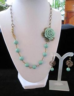 A vintage teal rose flower linked to teal pearls and brass chain, creates a blissful and romantic piece