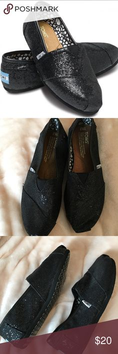 Black glitter TOMS Slightly worn black glitter TOMS. Toms Shoes Flats & Loafers