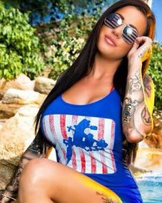 International Tattoo Model Heather Moss wearing the talesofthetatt.com Patriotic Tank Top.  This design is available in Tee's, Tanks, Zip up and pull over sweatshirts as well as long sleeve tee's all in the TOTT Gear Store at talesofthetatt.com/store  #talesofthetatt