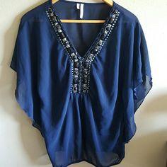 Sheer navy blue flutter sleeve top Sheer navy blue flutter sleeve top with black and silver embellishments. Studio Y Tops Blouses