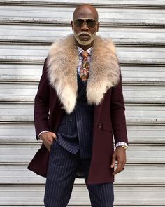 The WELTHE Guy in Purple Double Breasted Top Coat with Lynx Fur Collar and Navy Chalk Pinstripe Suit with Paisley Tie Mode Masculine, Sharp Dressed Man, Well Dressed Men, Mens Fur Collar Coat, Navy Dress Outfits, Sweater Dresses, Dress Shoes, Best Mens Fashion, Men's Fashion