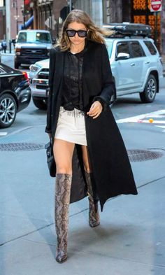 Gigi Hadid's best outfits: Knee high boots and a black full length coat.
