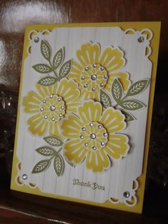handmade card ... montage of three large flowers ... cream, yellow, olive ...like the jewels on the flower centers ... Stampin' Up!