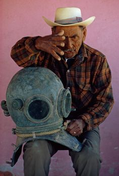 An old pearl diver in La Paz, Mexico, reminisces about an encounter with a shark, 1972.Photograph by Michael E. Long, National Geographic