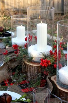Christmas Centerpiece: Cylinder Vases, Cedar Stumps as Candleholders, Epsom Salt Snow, Red Berries, Pine, and Burlap Garland.