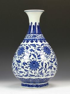 Chinese, 19th C., blue and white Yuhuchunping vase, flat rimmed, banded pattern at neck and base, decorated with blue floral and leaf design, Qianlong mark on base. Height 13 1/2 in.