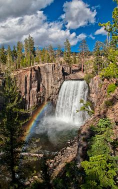 Devils Postpile National Monument's (california) iconic Rainbow Falls. Plunging 101-feet down to the turbulent water below, the falls are aptly named for the many rainbows that appear in its mist throughout sunny summer days.