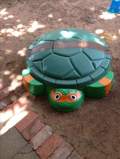 DIY Ninja Turtle Sandbox. Updated a turtle sandbox with mask and belt to turn into a Ninja Turtle.