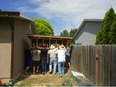 Volunteers from Austin's troop and ward help move the habitat they built for the Great Basin Wildlife Rescue.