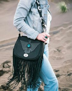 The Easy Rider saddle bag, captured at lake Wainamu; Black Chrysocolla crystal inlay Freebird motif Fringing Concho strap  Zip up lining  2 interior pockets  100% genuine leather $670 nzd. This bag is available for purchase ♠ Email us at warheadleathercraft@gmail.com , or send us a personal message to place an order ⚡⚡