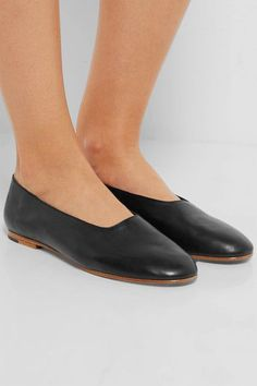 Heel measures approximately 10mm/ 0.5 inches Black leather   Slip on