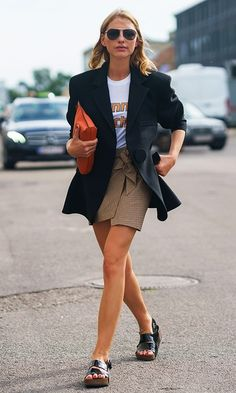 Copenhagen Fashion Week Street Style: black blazer, white graphic tshirt, plaid mini skirt, and leather slides
