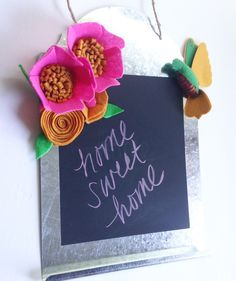 Metal and chalkboard sign with felt flowers by TheHappyDoorWreaths on Etsy https://www.etsy.com/listing/279779958/metal-and-chalkboard-sign-with-felt