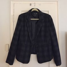 Black & Grey Plaid Pea Coat  FOREVER 21 While it looks like a blazer, it's heavy and can be worn on colder days. No pockets, two buttons in front. Comes up to waist. Bought 3 years ago, in great condition! Forever 21 Jackets & Coats Pea Coats
