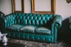 teal leather tufted sofa