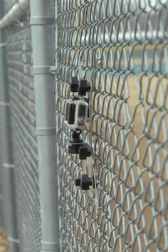 Field Side View Of A Lynkspyder Mounted To A Chain Link