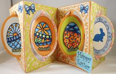 Candy Spiegel made this stunning Easter Accordion card where she combined the Accordion Oval Card die, The Oval Flourish Frame Edges, the Easter Eggs Peel-Offs and the Cool Diamond Silk Microfine Glitter. Candy colored with Copic Markers on top of the Glitter.