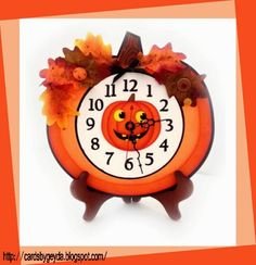 Misty loves clocks!  I think she says she has 40 plus clocks in her home!  From the MAISON de MADELINE, Misty used the Clock face and the Pumpkin base and the inside pumpkin are from MIDNIGHT JAMBOREE SVG KIT.  Both kits are excellent!  Isn't this the cutest, but not sure I could take all that ticking!