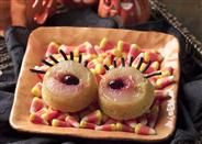 Eyeball Upside Down Cake: These cupcakes look right back at you. The fanciful topping of canned pear slices and cherries, arranged like a wide-open eyeball, mean that frosting is unnecessary. By using corn muffin mix for cake, the sugar content is lower --for an eye-popping Halloween treat.