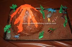 Homemade Dinosaur Land Volcano Cake: This homemade Dinosaur Land Volcano cake was pretty easy to make and my son loved it! I started out by baking 2 boxes of cake mix, one in an angel food