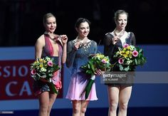 Second placed Russia's Anna Pogorilaya, winner Russia's Evgenia Medvedeva and third placed Italy's Carolina Kostner pose with their medals on the podium of the ladies free skating competition of the European Figure Skating Championship in Ostrava, Czech Republic on January 27, 2017. / AFP / JOE