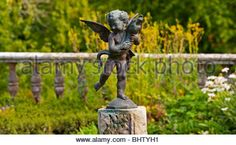 Cherub statue in garden Torosay Castle near Craignure on the Isle of Mull in the Inner Hebrides western Scotland - Stock Image