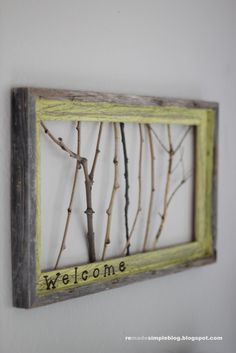 Found some sticks in my front yard, I hot glued them to the frame. I also sprayed them with gold glitter spray. I did not put welcome but a large wooden S in the corner.