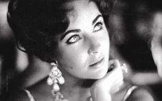 The wonderful Ms Taylor,   ~ iconic actress, notable humanitarian, spitfire of a woman. LOVE HER!   Great earrings.....