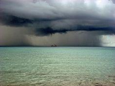Rain. Storm un the sea.