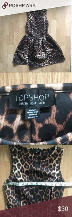TopShop Dress Size 4 TopShop Leopard Scuba Dress Size 4  Stretch all over  Pull over  Gently used in good condition    *please note*  No modeling, no trades, no transactions off the app Thanks for checking out my listing. Topshop Dresses