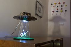 Alien Abduction light - UFO lamp, conceived by Lasse Klein is a unique lighting unit which is shaped like an alien saucer or a UFO.