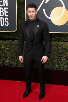 Nick Jonas wearing an all black Versace tuxedo paired with Versace dress shirt a - Tuxedo - Ideas of Tuxedo - Nick Jonas wearing an all black Versace tuxedo paired with Versace dress shirt and bow tie at the Annual Golden Globe Awards. Black Prom Tux, Black Suit Black Shirt, All Black Tuxedo, Black Tuxedo Wedding, Prom Tuxedo, Tuxedo For Men, Black Suits, All Black Mens Suit, Outfit Hombre Formal