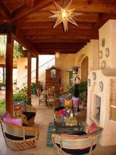 Santa Fe style gardens:A covered patio adds comfort while blending your outdoor space with the style of your home. Integrated hooks are ideal for accenting your look with lush hanging baskets that complement the southwestern flair. Southwestern Chairs, Southwestern Home, Southwest Decor, Southwestern Decorating, Southwest Style, Outdoor Rooms, Outdoor Living, Ideas Terraza, Santa Fe Style