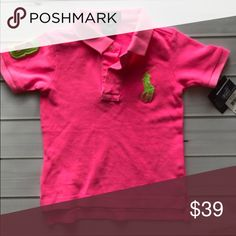 Hot pink polo Never worn.  New with tags. Slight fading on collar. But never worn with tags. Ralph Lauren Shirts & Tops Polos