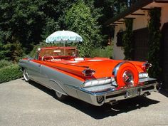 1959 Oldsmobile Convertible, Orange and White with continental kit