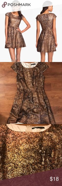"Metallic Lace Kensie Dress Metallic foil lace dress from Kensie Shimmery tan/gold/brown color depending on the lighting.  The lace has a light paisley pattern to it that makes it really stand out Beautiful form fitting, A-line dress.  Bought from another posher but didn't end up wearing it to my event.  Size Small but could also fit a smaller medium Shoulder to hem 33"" waist flat 13"" Kensie Dresses Mini"