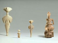 Group of Idols and Goddess (?)    a - c Idol (star-gazers)  Marble  H: 5.45cm  Asia Minor  Anatolian, Kilia type  Lte 4th-early 3rd millenium B.C.?    d. Goddess (?) on throne  Alabaster  H: 17.25 cm  Asia Minor  Anatolian  Late 3rd - early 2nd millenium B.C.