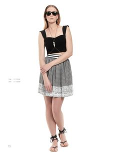A black cropped top and a mini checked skirt create the most stylish morning outfit!